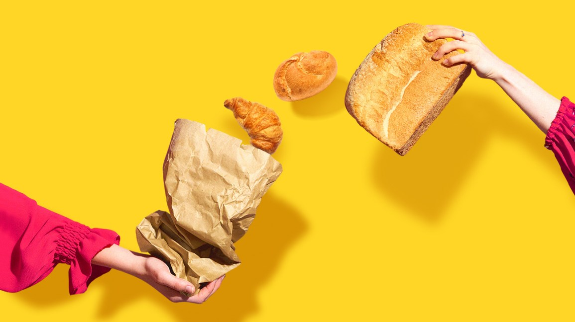 croissant and bread coming out of a bag