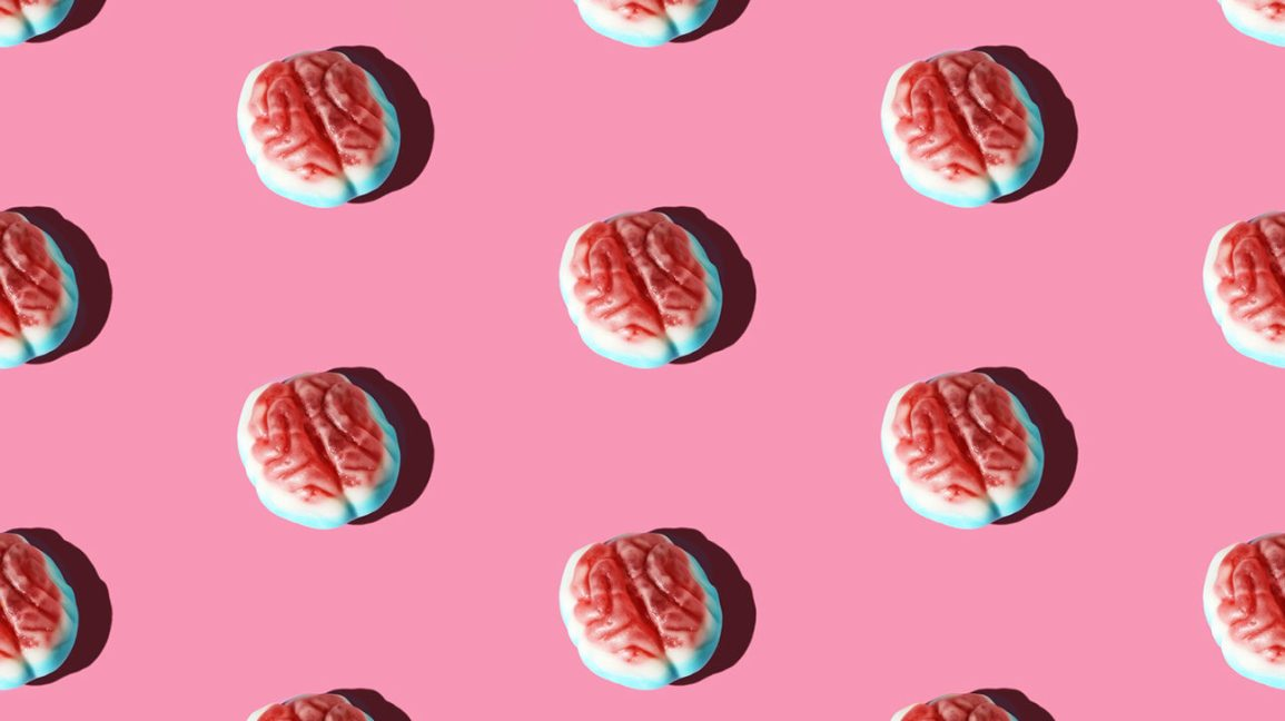 Brain Candy Arranged In A Pattern On A Pink Background