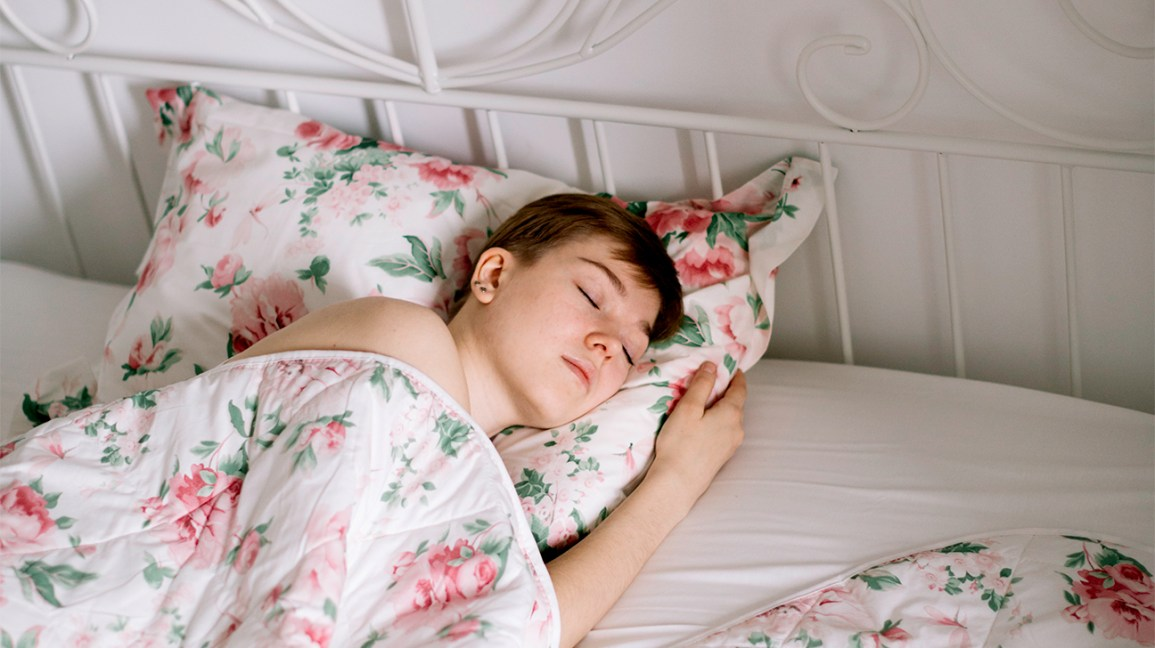 woman sleeping in floral sheets