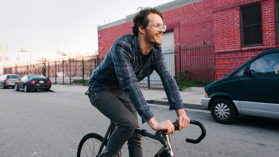 man biking to help the environment