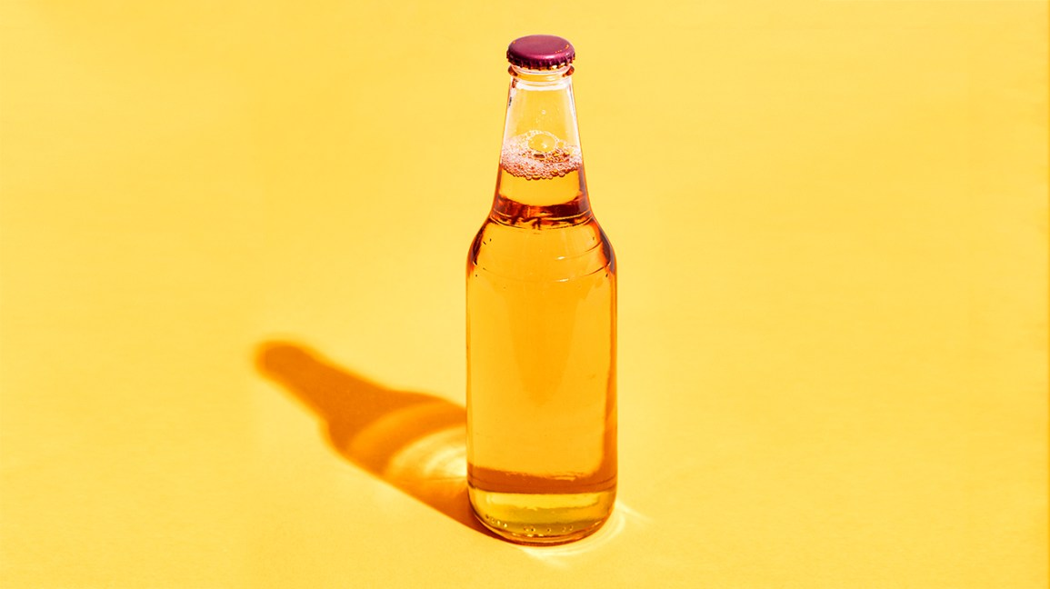 bottle of beer on a yellow background