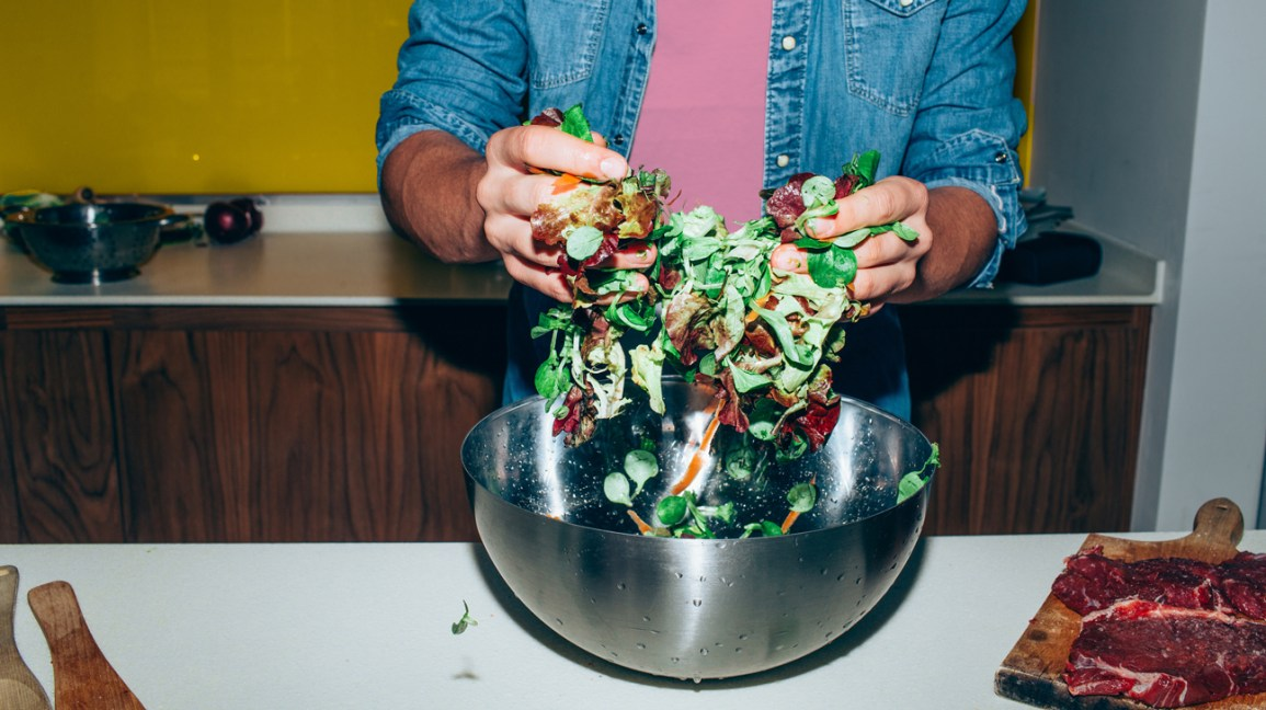 Man making a salad: Kitchen Hacks to Save Time