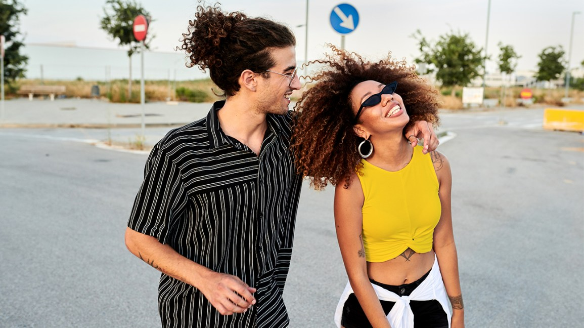 smiling couple with curly hair
