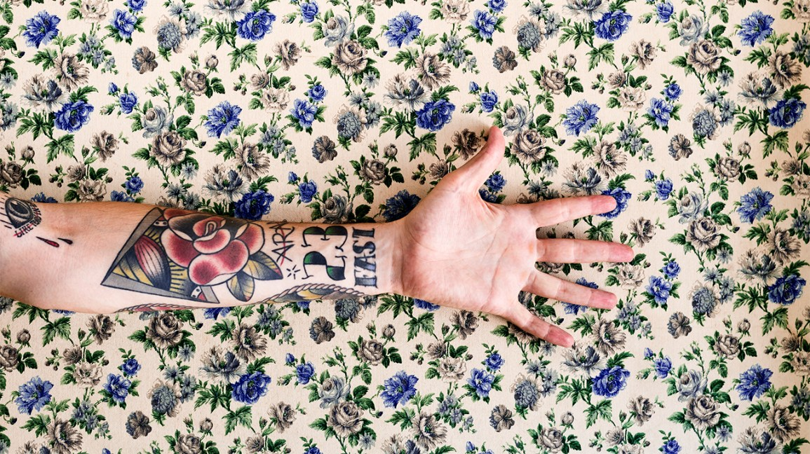 arm tattoo on floral background