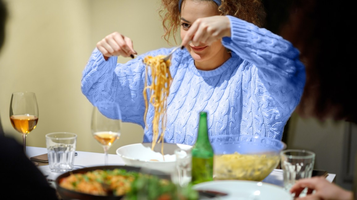 young woman serving up spaghetti