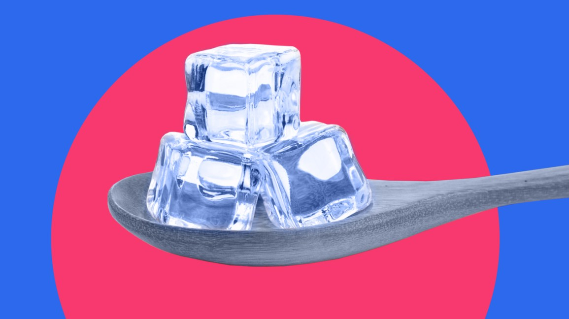 Ice cubes on spoon on red and blue background header