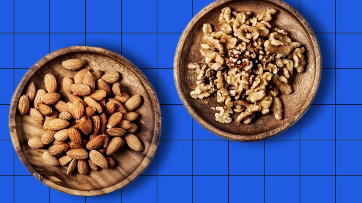 bowl of almonds and a bowl of walnuts on a blue background header