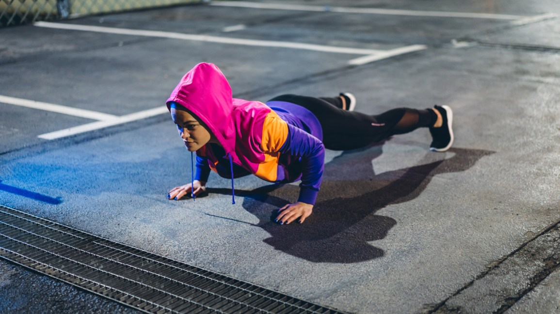young woman holding a plank exercise