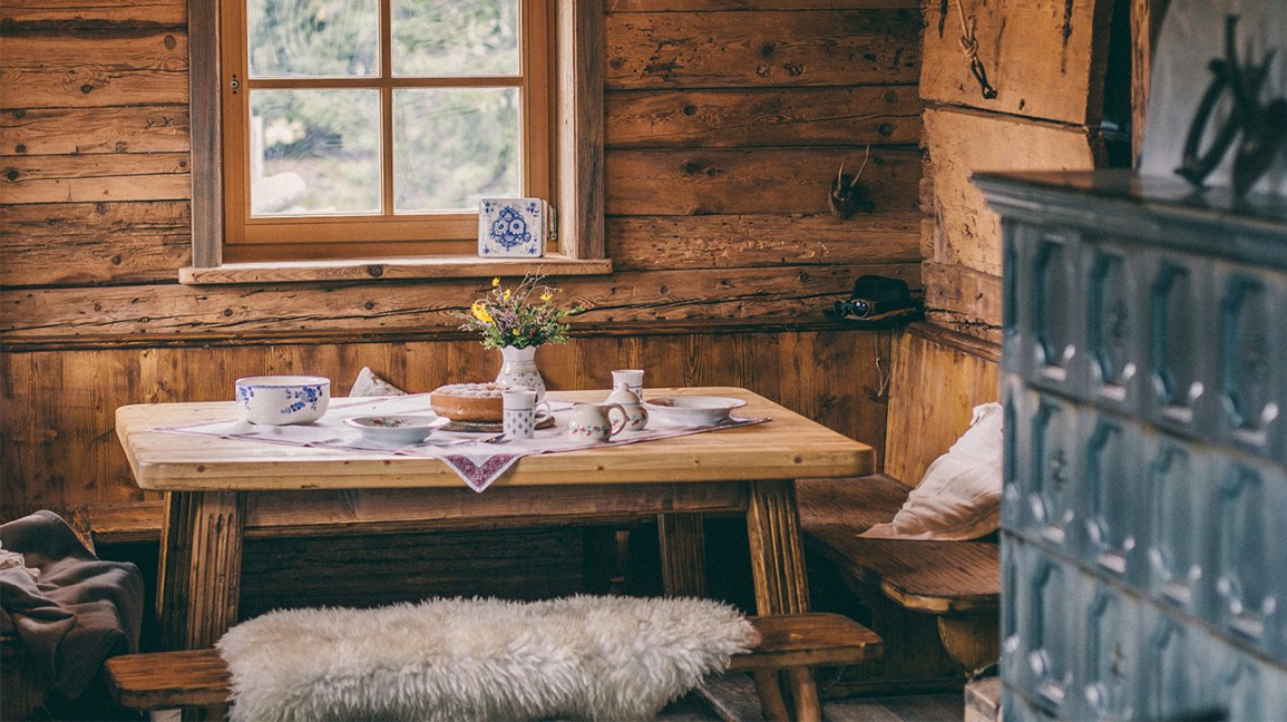 rustic design; wooden kitchen table in a cottage