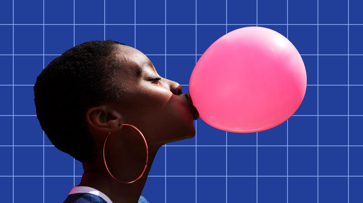 Woman blowing pink bubble because she's confident and awesome header