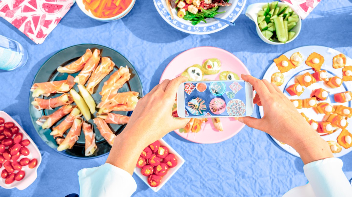 person capturing food on phone for noom header