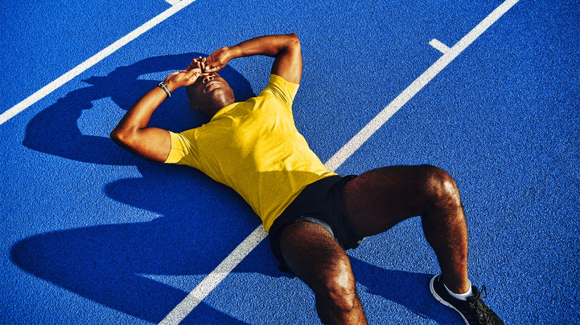 Runner thinking about Common Running Injuries and How to Avoid Them