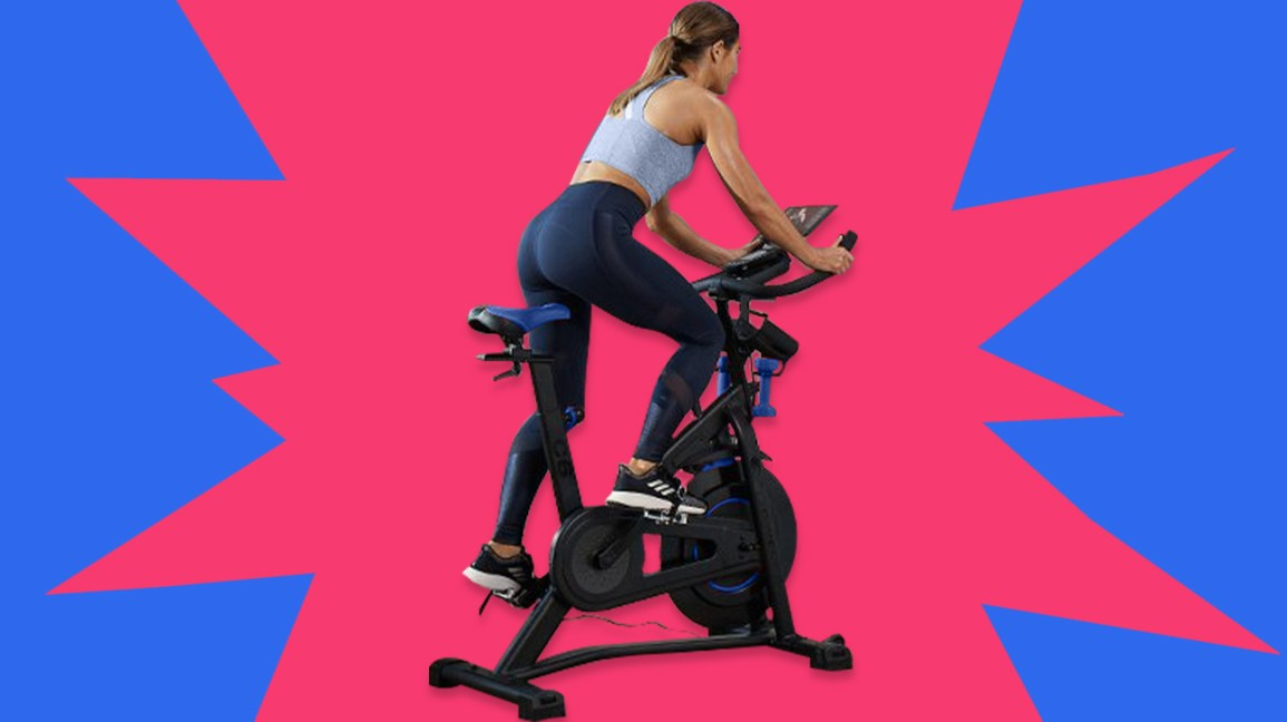 woman riding Bowflex stationary bike
