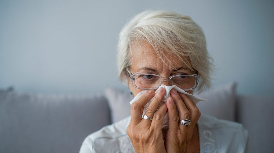 Woman with cold symptoms