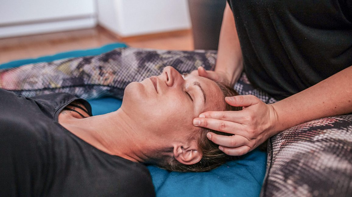 Person massaging facial pressure points