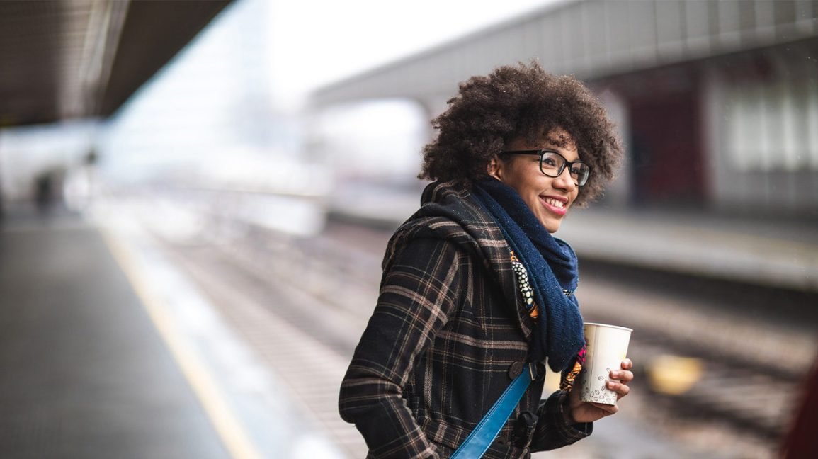 woman commuting to work holding coffee