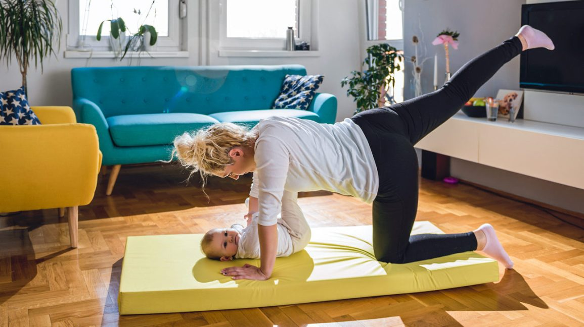 new mother finding balance by exercising at home