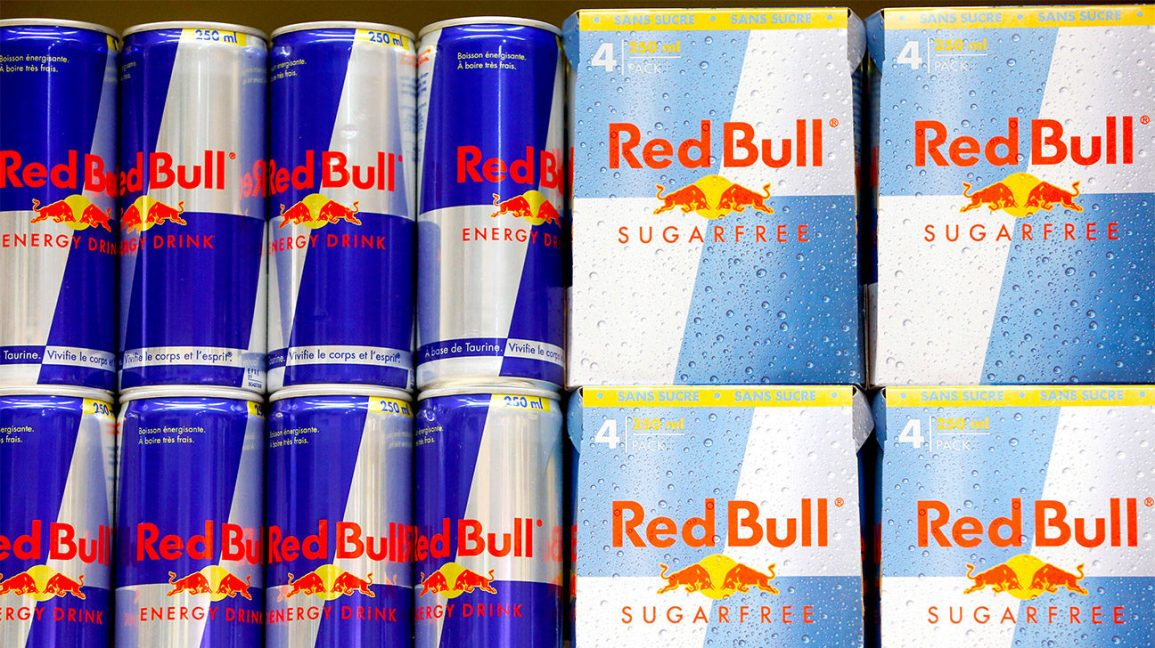 A shelf with regular and sugar-free Red Bull