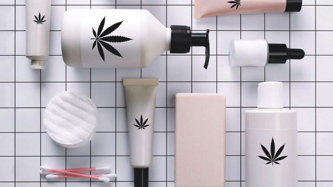 bottles of lotions with cannabis leaves on the labels