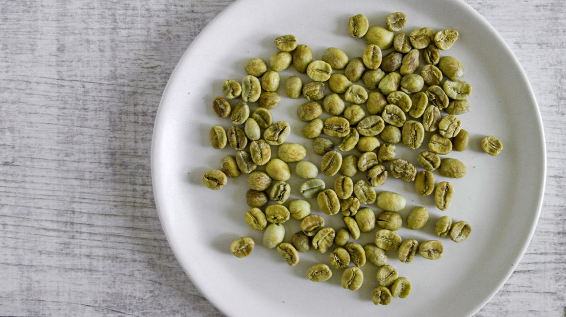 A plate with green coffee beans