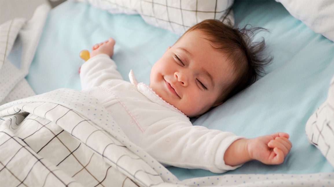 When Is It Safe for My Baby to Sleep with a Blanket?