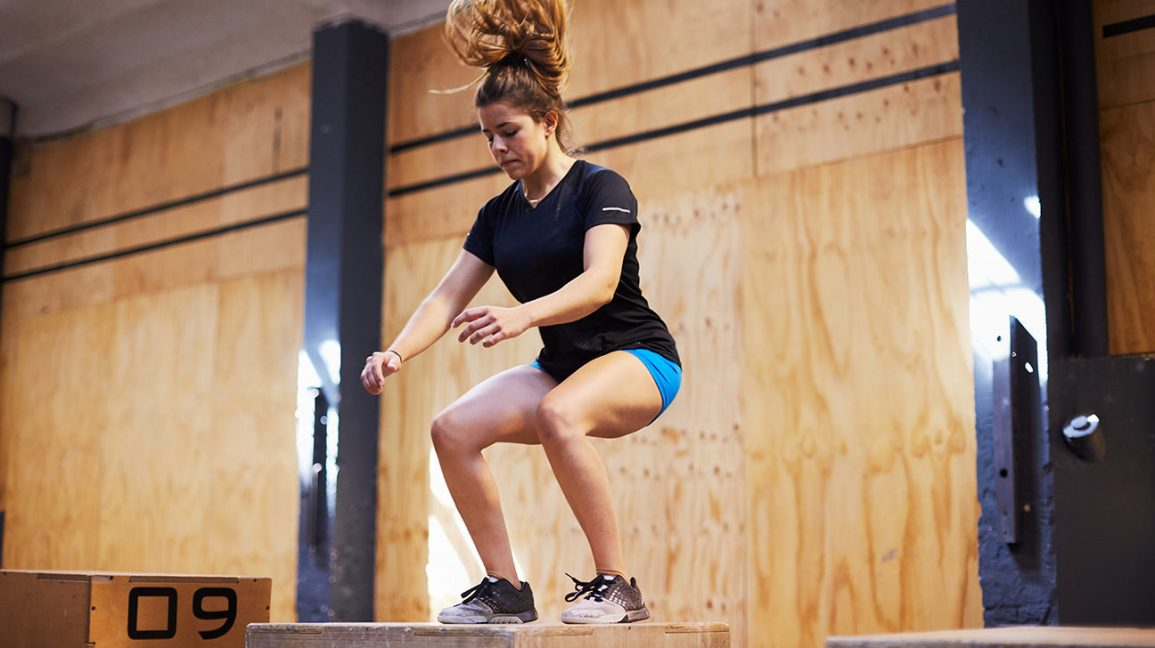 woman doing a box jump