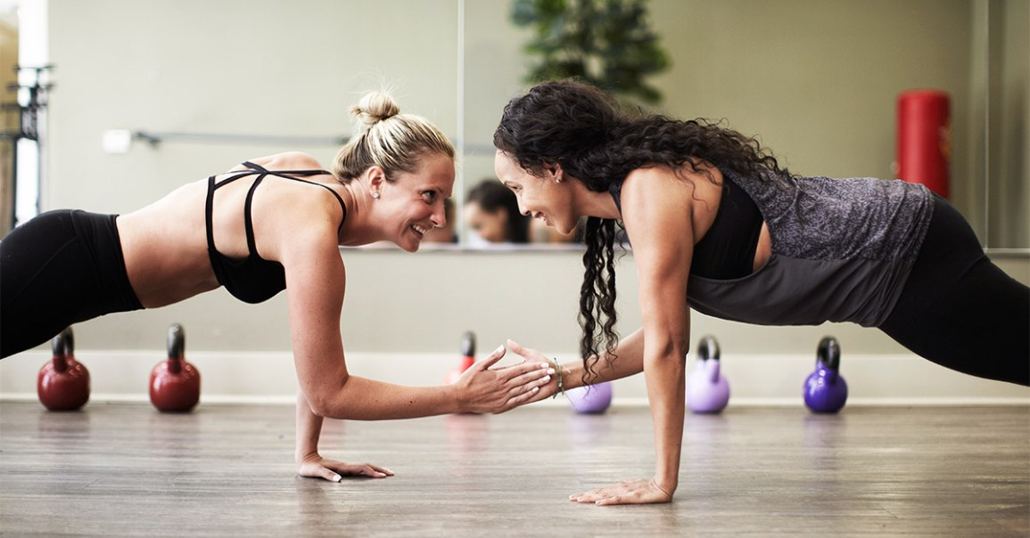 two people performing a partner plank with a clap