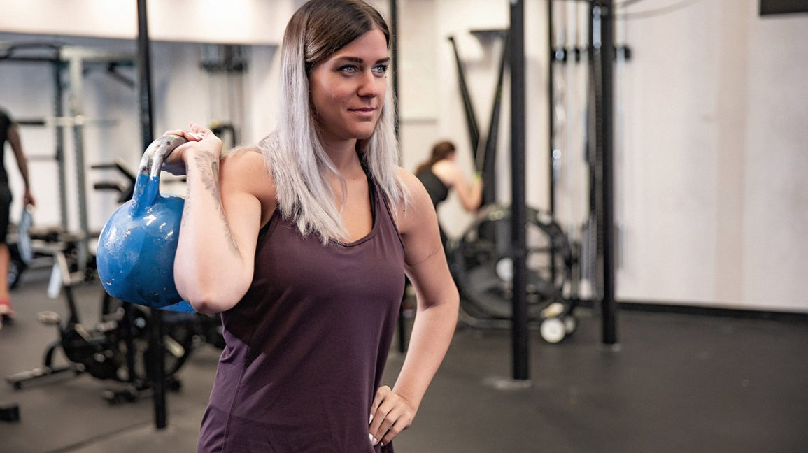 person at the gym holding a kettlebell
