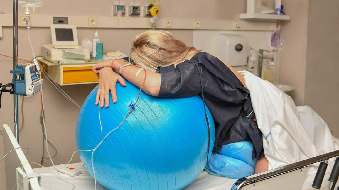 patient uses birthing ball during labor and delivery