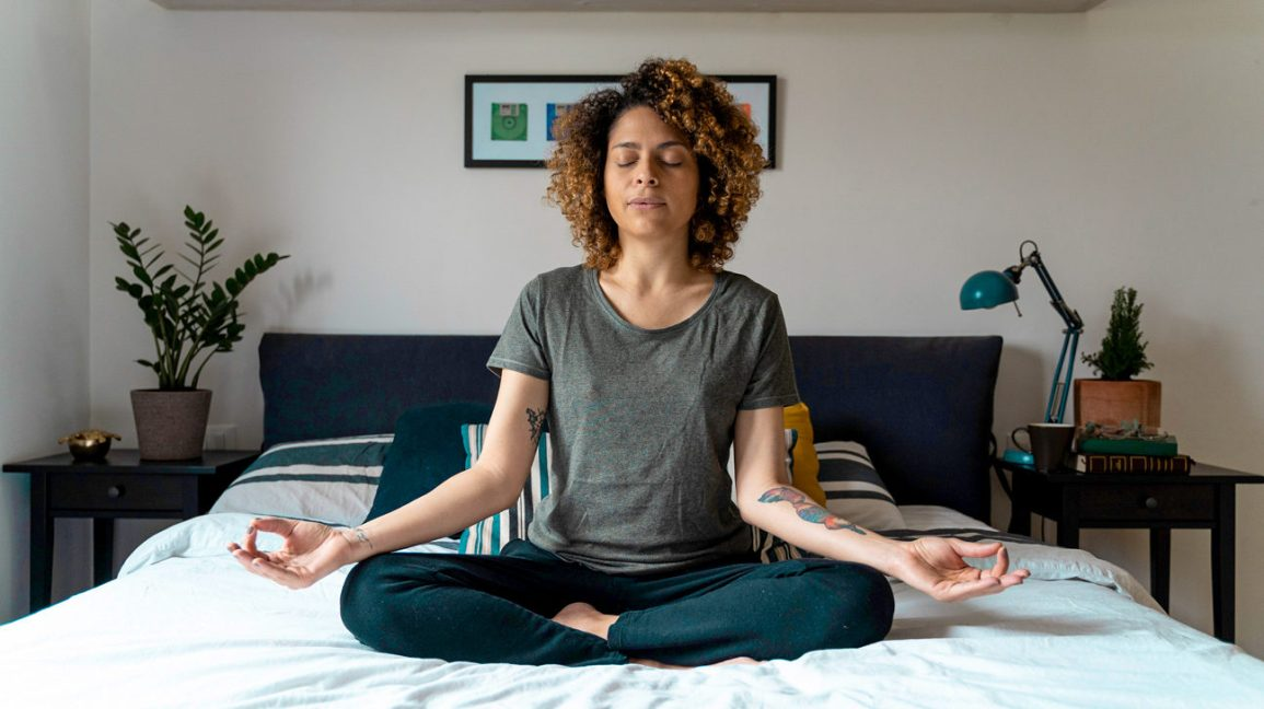 Person meditating to reduce anxiety