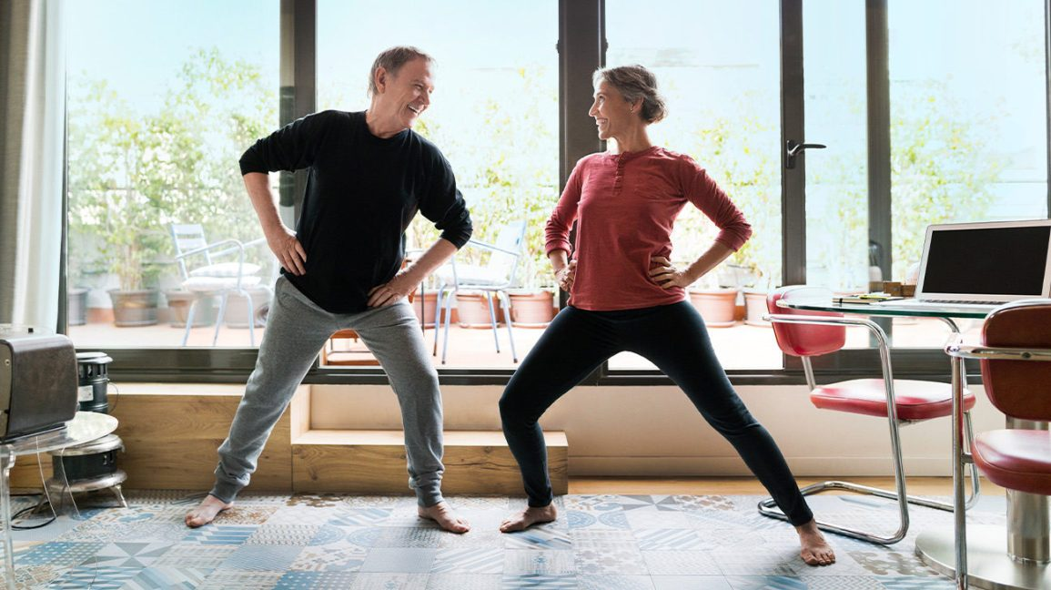 Couple stretching to increase leg circulation