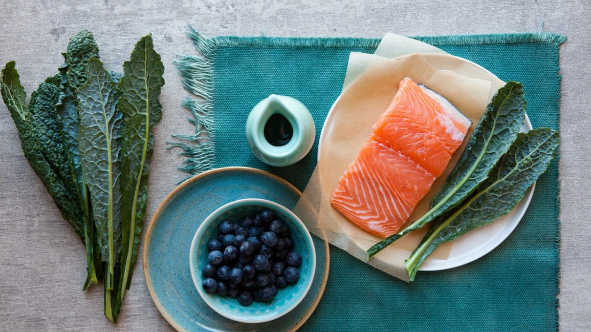 Salmon, blueberries, and greens that fit Whole30 or paleo