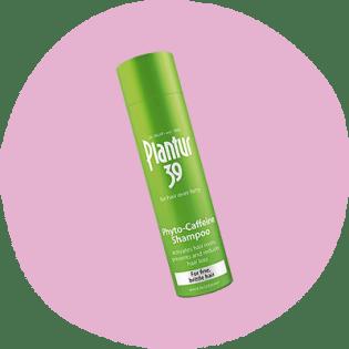 Bottiglia verde di Plantur 39 shampoo alla caffeina per la caduta dei capelli
