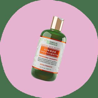 Bottiglia verde e arancione di shampoo Botanical Hair Growth Lab