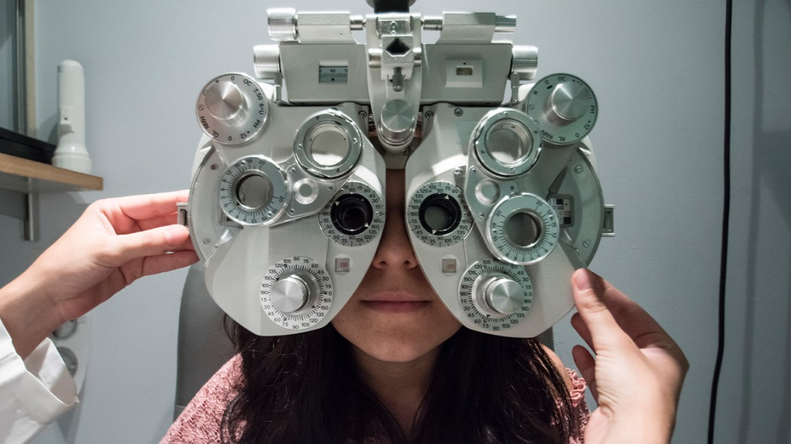 A woman having her eyes examed