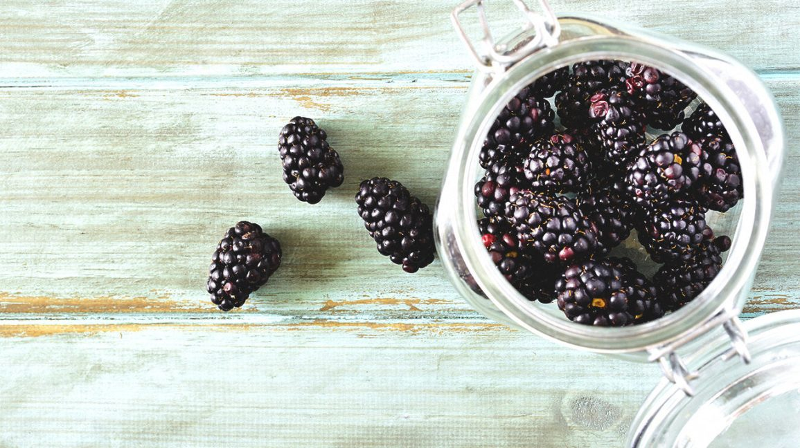 A jar of fresh blackberries