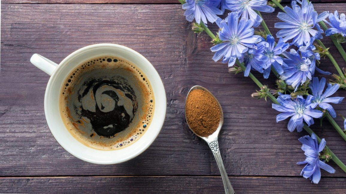 chicory root coffee in a cup and spoonful of chicory root powder