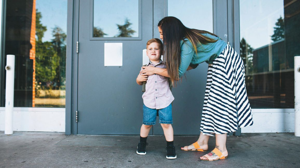 Mom with male child at school