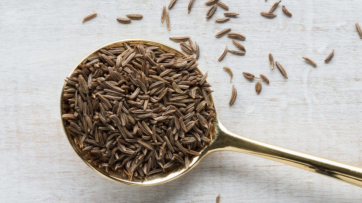 caraway seeds in a spoon