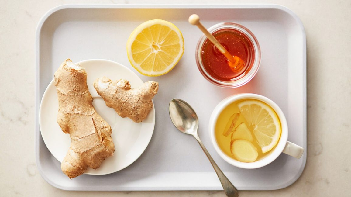 a platter with ginger, lemon, honey, and tea