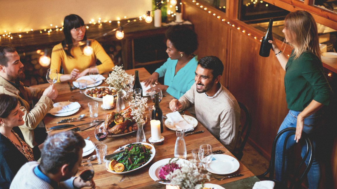 a family around the table for a holiday dinner