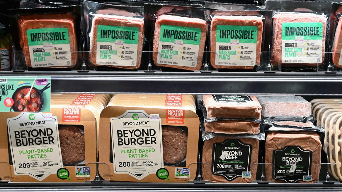 Beyond Burger and Impossible Burger on a supermarket shelf