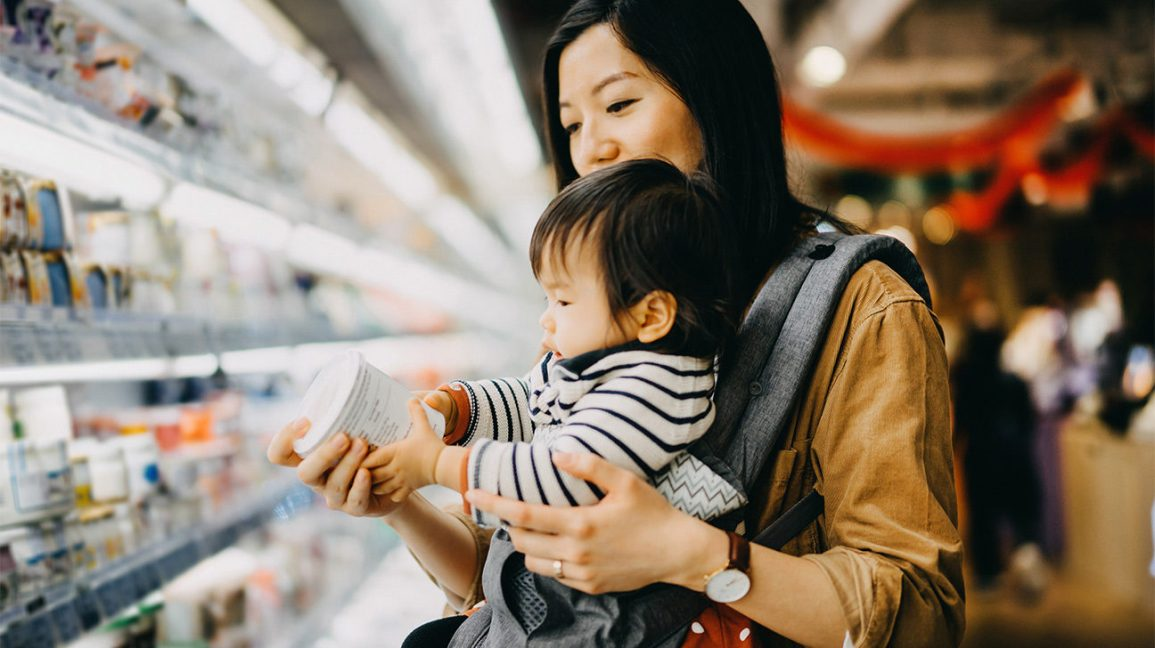 Mother with young child looking for functional foods at the supermarket