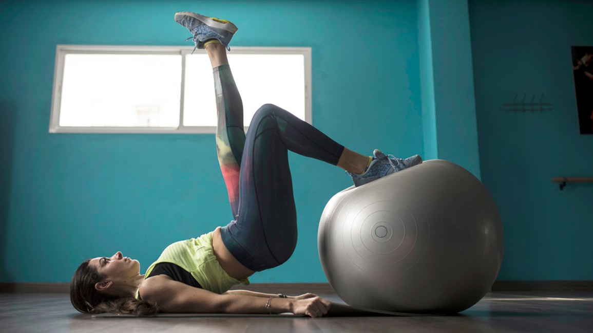 woman doing a ball exercise