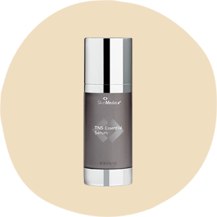 SkinMedica TNS Essential Serum in a dark gray pump bottle with a silver lid