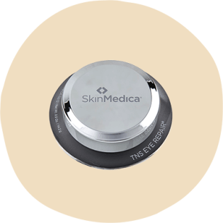 SkinMedica TNS Eye Repair in a dark gray screw-top jar with a silver lid