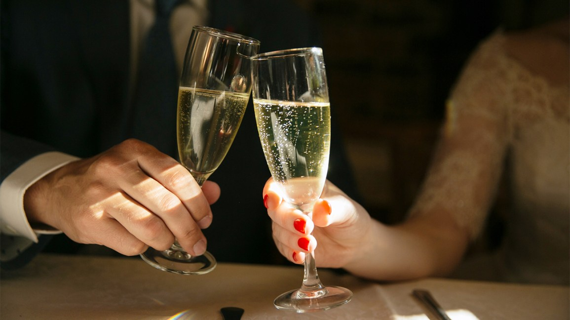 Two people toasting with champagne