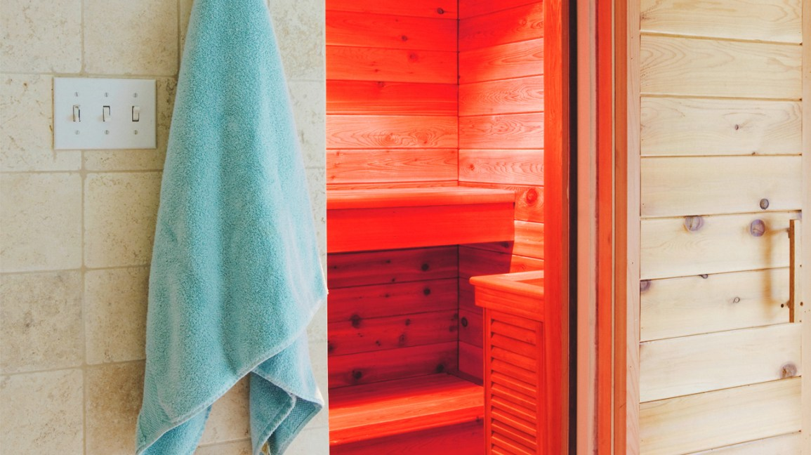 red light inside a wooden sauna