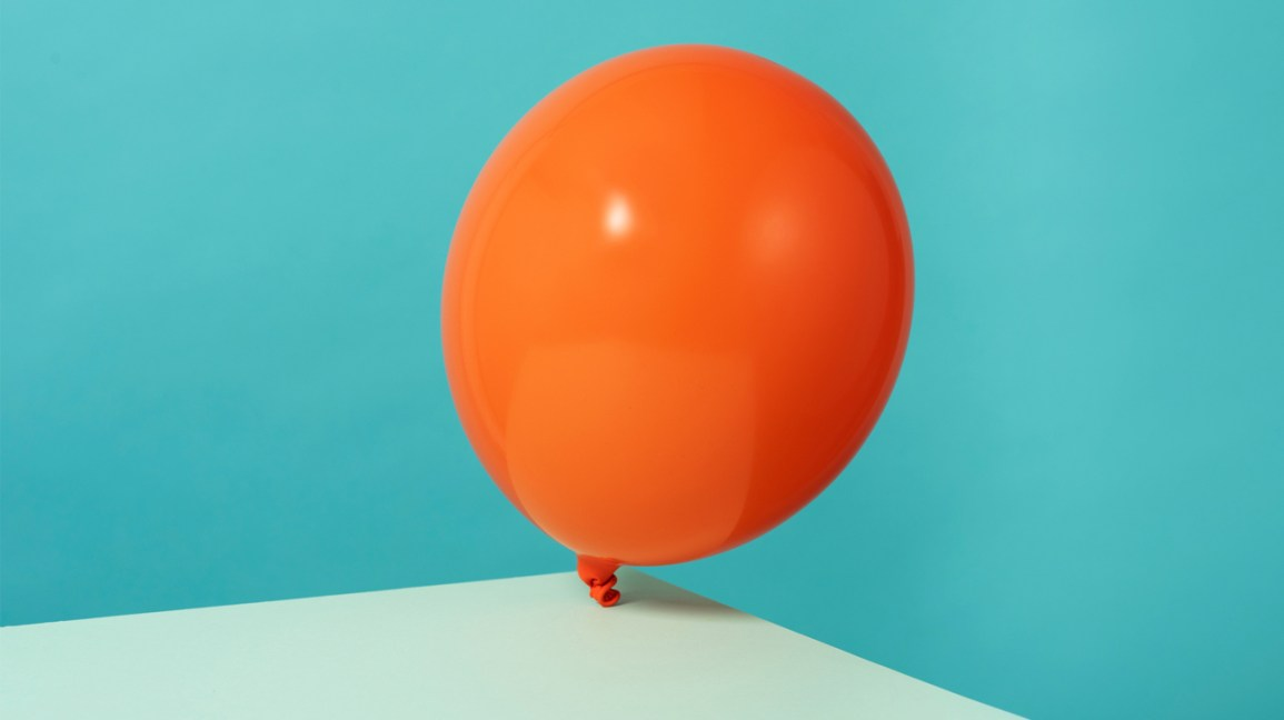 An image of an orange balloon to help explain what endo belly feels like.