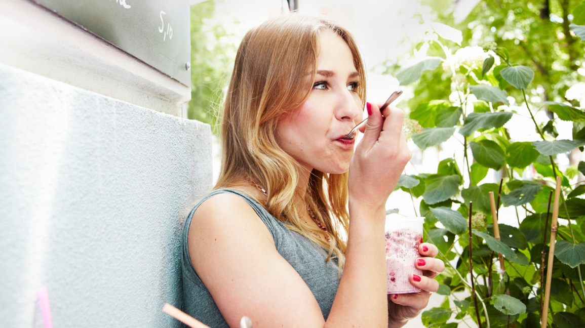 This image has an empty alt attribute; its file name is woman_eating_yogurt-1296x728-header.jpg